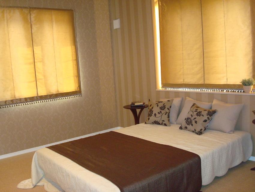 シックで落ち着いた雰囲気の主寝室。